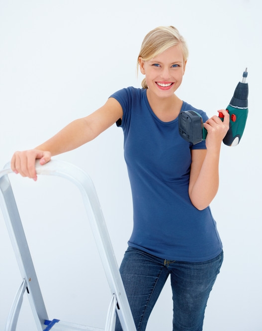 Beauty woman with drill machine on white background